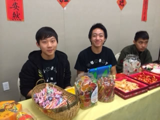 student volunteers at the food table