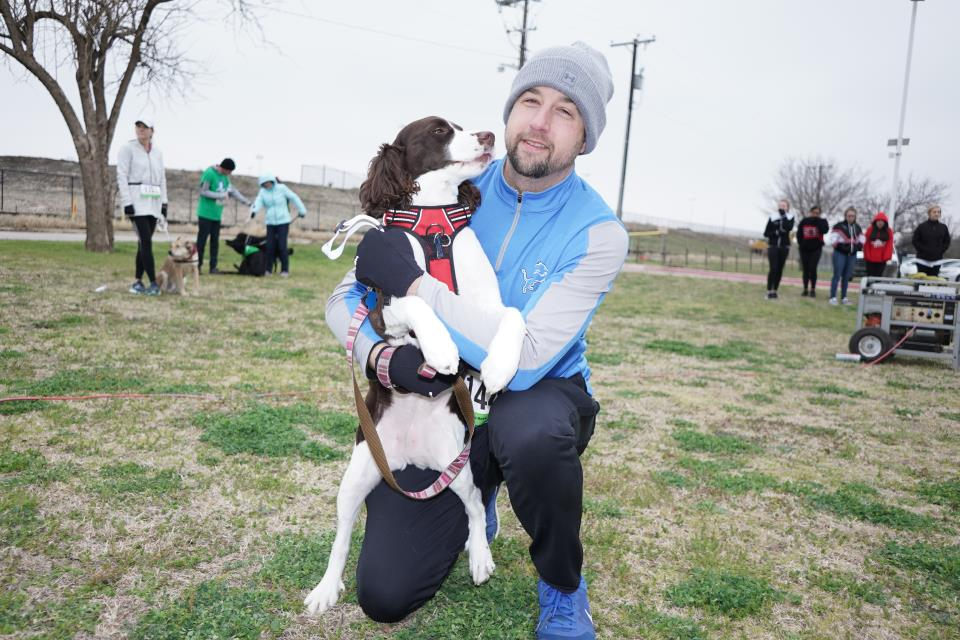 Run for Rover runner with his dog