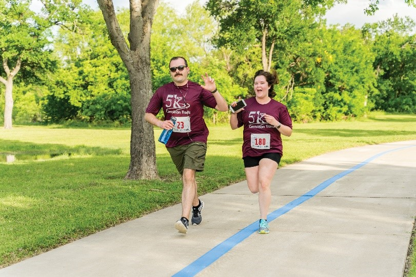Man and woman running in 5K race